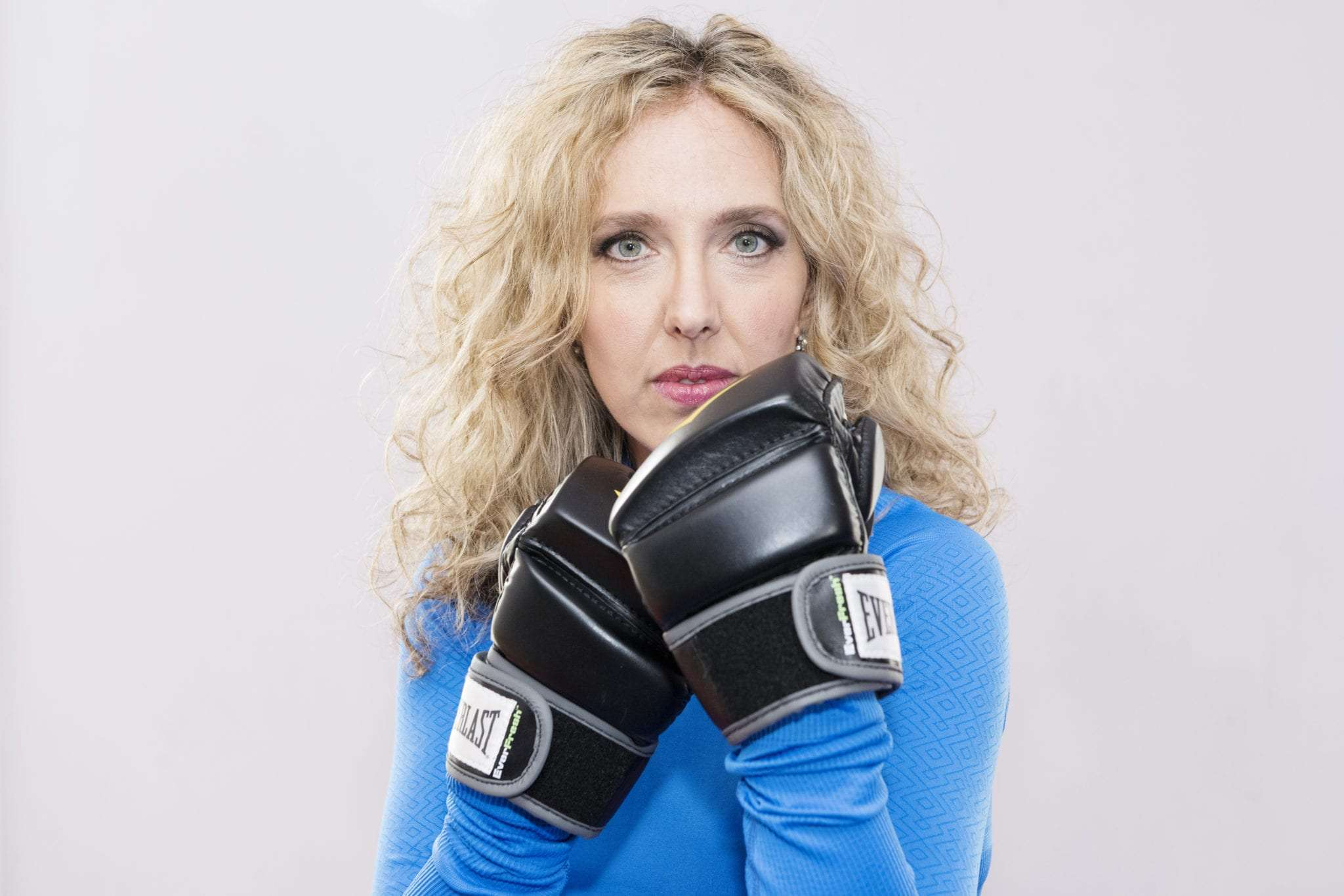 photography, brand strategy, visual story teller, working with a fitness instructor holding boxing gloves