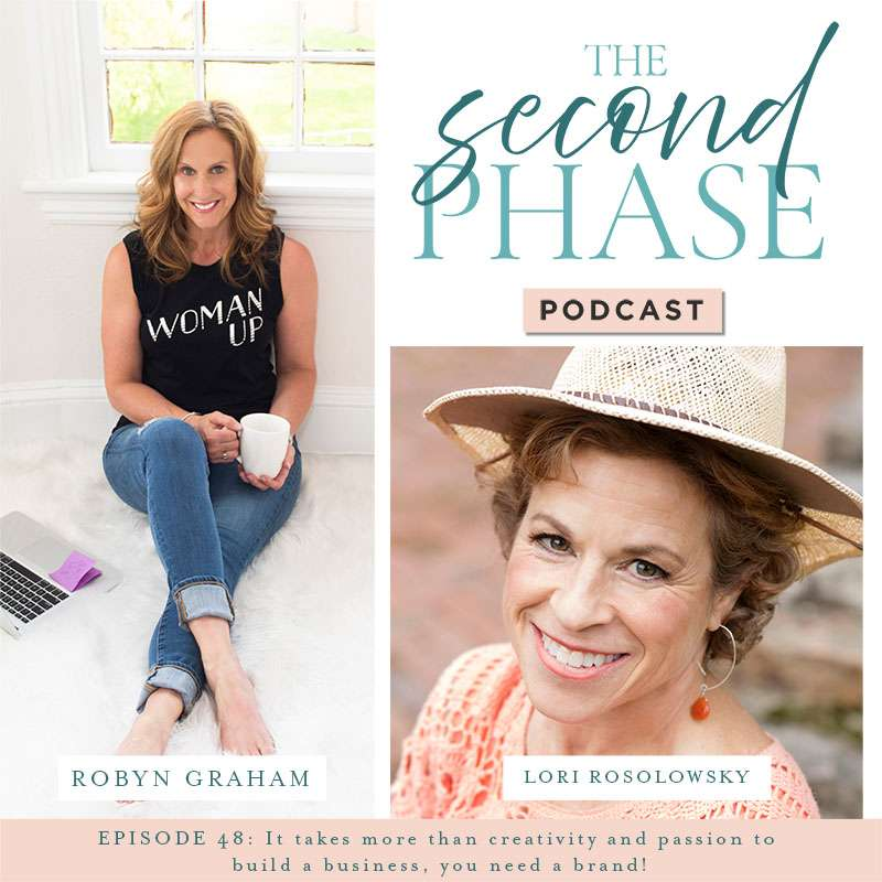 Lori Rosolowsky interviewed on the second phase podcast to discuss creating a business from the art we create. On the podcast graphic is a photo of Lori on the bottom right hand corner under the logo wearing a coral sweater and a straw cowboy hat smiling and looking up at the camera. On the left of the graphic is a photo Robyn sitting on a white rug wearing jeans and a black sleeveless tee that says woman up on the front.